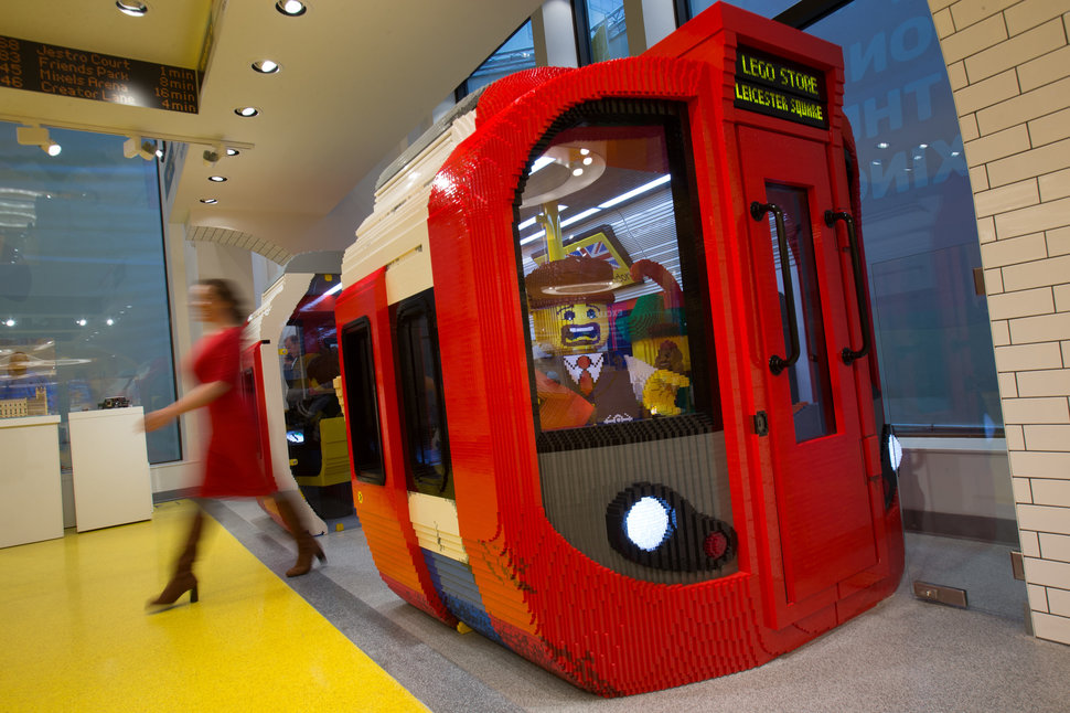 An employee poses leaving a London Underground tube train carriage made from LEGO pieces before the official opening of the new LEGO store in Leicester Square, central London in November 17, 2016. Billed as the world's largest LEGO store by the company, the new UK flagship store was officially opened on November 17 in Leicester Square. / AFP / Daniel LEAL-OLIVAS (Photo credit should read DANIEL LEAL-OLIVAS/AFP/Getty Images)